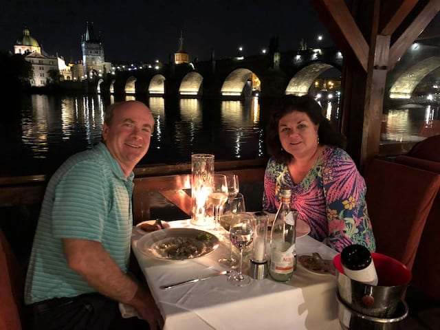 Having dinner by the Charles Bridge in Prague